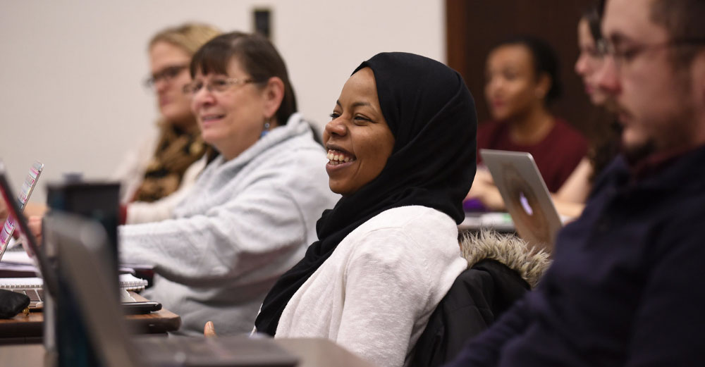 Woman smiles during class